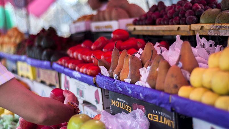 Produce shopping in an open air market